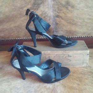 Strappy black heels with ankle bow, size 6.5